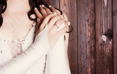 closeup of a bride's hands with ring against wooden background