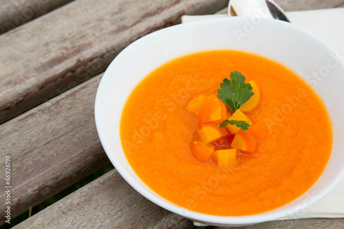 A plate of carrot soup