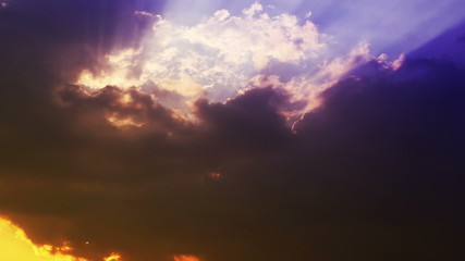 Sunset in clouds. Yellow and Blue. 4K.