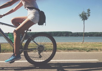 Riding bicycle by the river