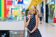 attractive blond woman with credit cards