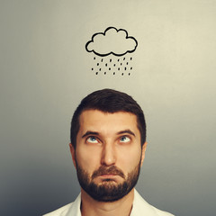 stressed man with drawing storm cloud