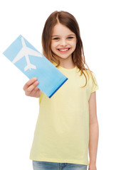 smiling little girl with airplane ticket
