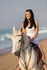young caucasian woman horse ride on beach