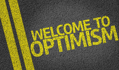 Welcome to Optimism written on the road