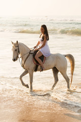 happy young lady horse ride on beach
