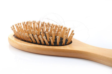 Wooden comb brush with lost hair