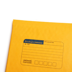 Yellow letter envelope isolated over white