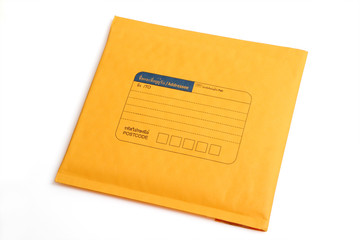 Yellow letter envelope isolated with clipping path.