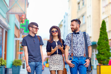 stylish friends walking the city street