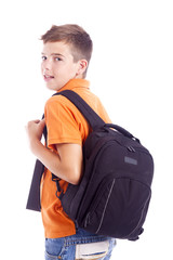 Portrait of a school boy with backpack holding a notebook, isola