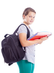 Portrait of a smiling school girl with backpack holding notebook