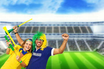 Brazilian couple supporters at stadium