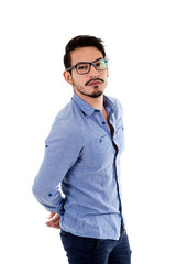 young hispanic man with blue shirt and glasses arms behind