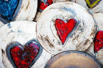 ceramic plates with colorful hearts