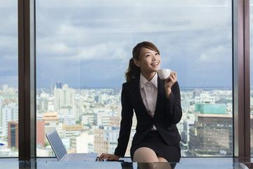 Asian business woman take a break