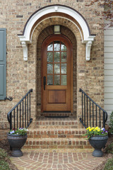 Wooden front door of family home with arch