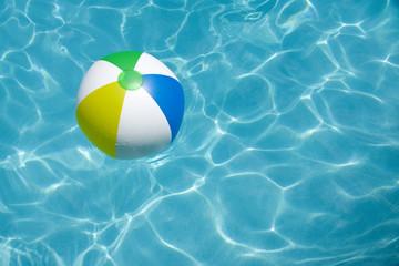 Beach Ball Floating in Pool