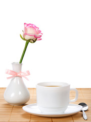 Rose in vase with, tea-things