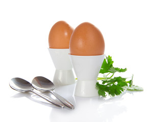 Support with eggs, teaspoons and the parsley