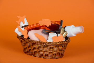 Cosmetic set, soap and safety razor in basket