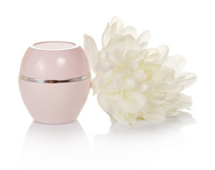Small jar with cosmetic cream and chrysanthemum