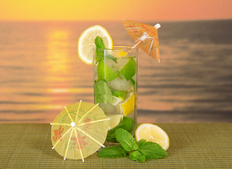 Mojito with umbrellas and lemon