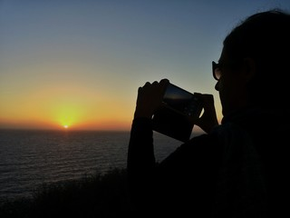 Photographer silhouette on sunset