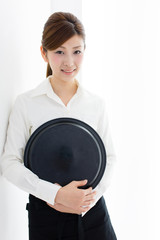 young asian waitress in white room