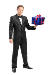 Full length portrait of an elegant man holding a present