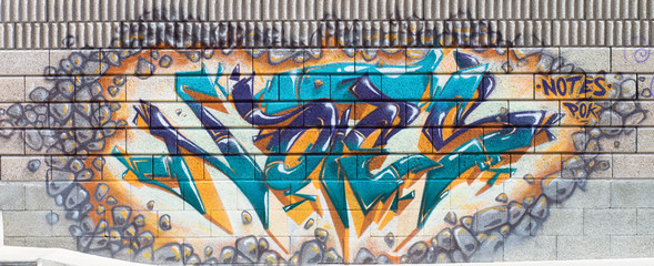 Colorful graffiti on a legal wall in public skatepark