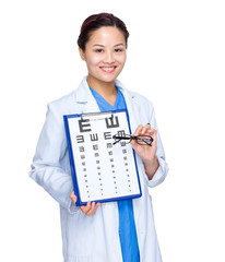 Female doctor with eye chart and glasses