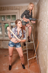 Attractive women work with puncher and hammer
