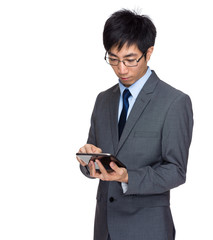 Businessman look at digital tablet