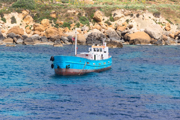 blue boat at port of city Mgarr Malta