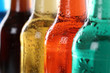 Leinwandbild Motiv Bunte Getränke mit Cola in Flaschen