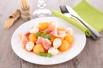 salad with melon,mozzarella and prosciutto