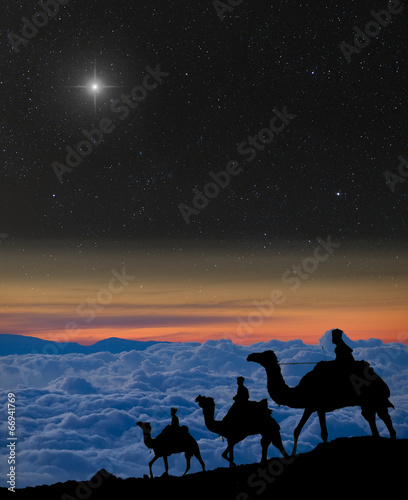 The 3 wise men follow Christmas star over the mountains. - 66941769