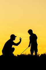 Golf sunset silhouette