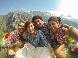 Friends Taking Selfie at Top of Mountain