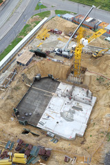 Build of tower crane, building foundation and machines