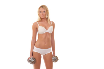 girl in white lingerie with dumbbells on white