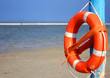 pole with lifejacket at sea on the beach 2 - 66943306