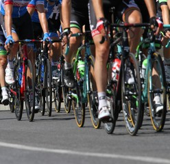 Group of cyclists ride uphill vigorously during the cycling race
