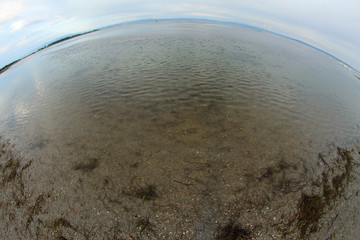 sea and the beach with fisheye lens
