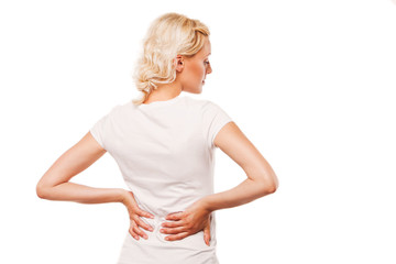 Woman with backache. Female holding her painful back