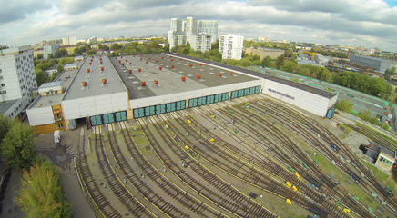 Depot with many railways at day in city at cloudy day