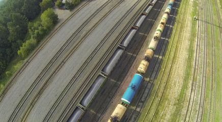 Freight trains on railways at sunny day.