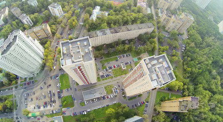 Above view of two high residential buildings in neighborhood.