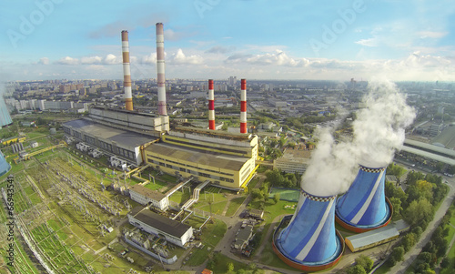 Territory of power plant with many pipes at sunny day - 66943541
